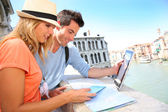 Tourists using digital tablet on the Rialto bridge — Stock Photo