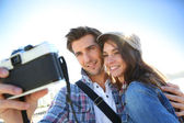 Couple taking picture of themselves — Stock Photo