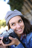 Trendy girl holding camera — Stockfoto