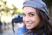 Trendy girl holding camera — Foto de Stock