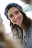 Girl wearing hat in fall — Stock Photo