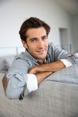 Man relaxing in sofa — Stock Photo