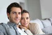 Couple at home relaxing in sofa — Stock Photo