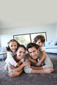 Family relaxing on carpet — Stock Photo