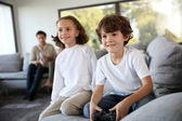 Kids playing video game — Stock Photo