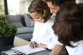 Daddy having fun with kids drawing — Stockfoto