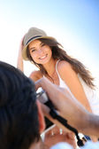 Man taking picture of woman — Stock Photo