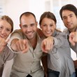 Business people pointing at camera — Stock Photo
