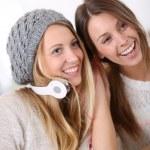 Girlfiends having fun listening to music — Stock Photo #35312269
