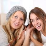 Girlfiends having fun listening to music — Stock Photo #35312351