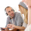 Stock Photo: Guy with music headset on
