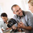 Stock Photo: Students in photography working together