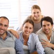 Friends sitting in sofa — Stock Photo