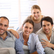 Stock Photo: Friends sitting in sofa
