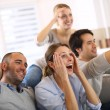 Friends watching football game on tv — Stockfoto