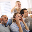Stock Photo: Friends watching football game on tv