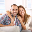 Couple sitting in sofa at home — Stock Photo