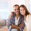 Couple smiling towards camera — Stock Photo #35314531