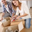 Young adults moving in new home — Stock Photo #35314667
