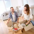 Stock Photo: Young adults moving in new home