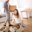 Young adults moving in new home — Stock Photo #35314707