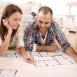 Couple looking at construction house plan — Stock Photo #35314761