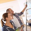 Couple choosing color for walls — Stock Photo
