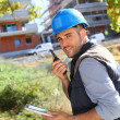 Foreman on site using walkie talkie — Stock Photo