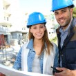 Smiling architects standing on construction site — Stock Photo
