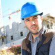 Stock Photo: Construction manager with security helmet
