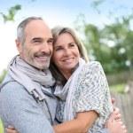 Senior couple enjoying peaceful nature — Stock Photo