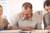 Man filling in application form — Stock Photo