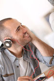 Guy listening to music with headset on — Stock Photo