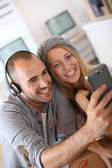Friends listening to music — Stock Photo