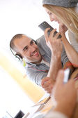 Man talking picture of girlfriend — Stock Photo
