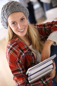 Student girl holding school books — Stock Photo