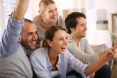 Friends watching football game on tv — Stock Photo