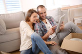 Adults using tablet — Stock Photo