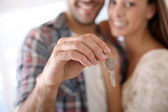 House key held by young man — Stock Photo