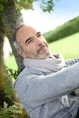 Man sitting in park — Stock Photo