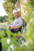 Man relaxing in country house — Stock Photo