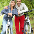 Senior couple with bicycle — Stock Photo #35323239