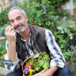 Mature man in garden — Stock Photo