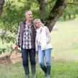 Senior couple walking in countryside — Stok fotoğraf