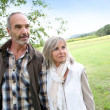 Senior couple walking in countryside — Stock fotografie