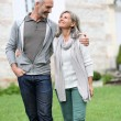 Stock Photo: Mature couple walking in garden