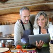 Senior couple in home kitchen — Stock Photo #35321981