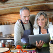 Senior couple in home kitchen — Stock Photo