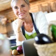 Senior woman in kitchen — Stock Photo