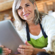 Senior woman cooking — Stock Photo
